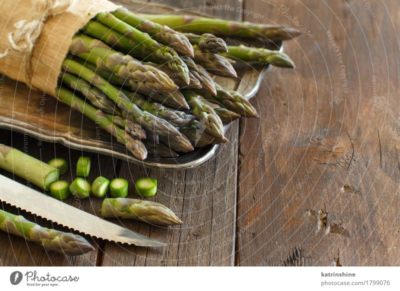 Fresh asparagus with knife Vegetable Nutrition Dinner Vegetarian diet Knives Table Healthy Natural Brown Green Asparagus food Gourmet wood Sliced health