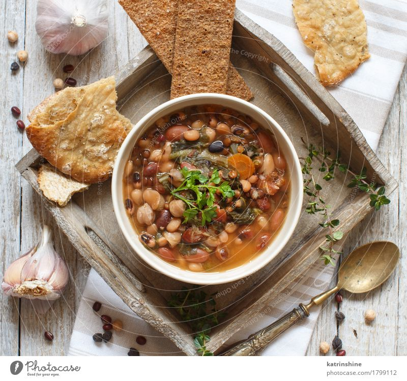 Cooked legumes and vegetables in a bowl Vegetable Bread Soup Stew Herbs and spices Nutrition Vegetarian diet Bowl Spoon Wood Delicious Natural Brown Green Red