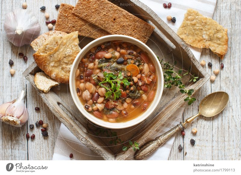 Cooked legumes and vegetables in a bowl Food Vegetable Bread Soup Stew Herbs and spices Nutrition Vegetarian diet Bowl Spoon Wood Delicious Natural Brown Green