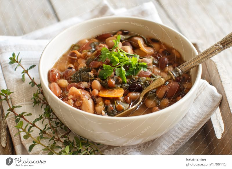 Cooked legumes and vegetables in a bowl Food Vegetable Bread Soup Stew Herbs and spices Nutrition Vegetarian diet Diet Bowl Spoon Wood Healthy Delicious Brown