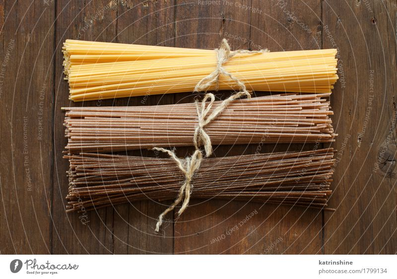 Italian spaghetti on the old wooden table Dough Baked goods Nutrition Table Brown background board country Cooking Culinary food Ingredients mediterranean Menu