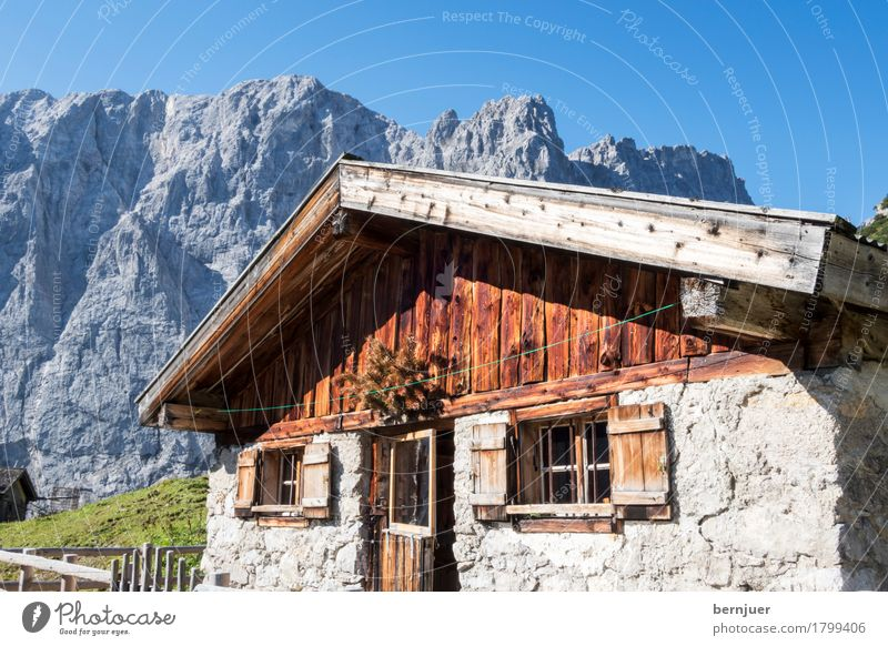 hut Sunlight Autumn Weather Beautiful weather Rock Alps Mountain Peak Village House (Residential Structure) Hut Old Authentic Blue Nostalgia Alpine pasture