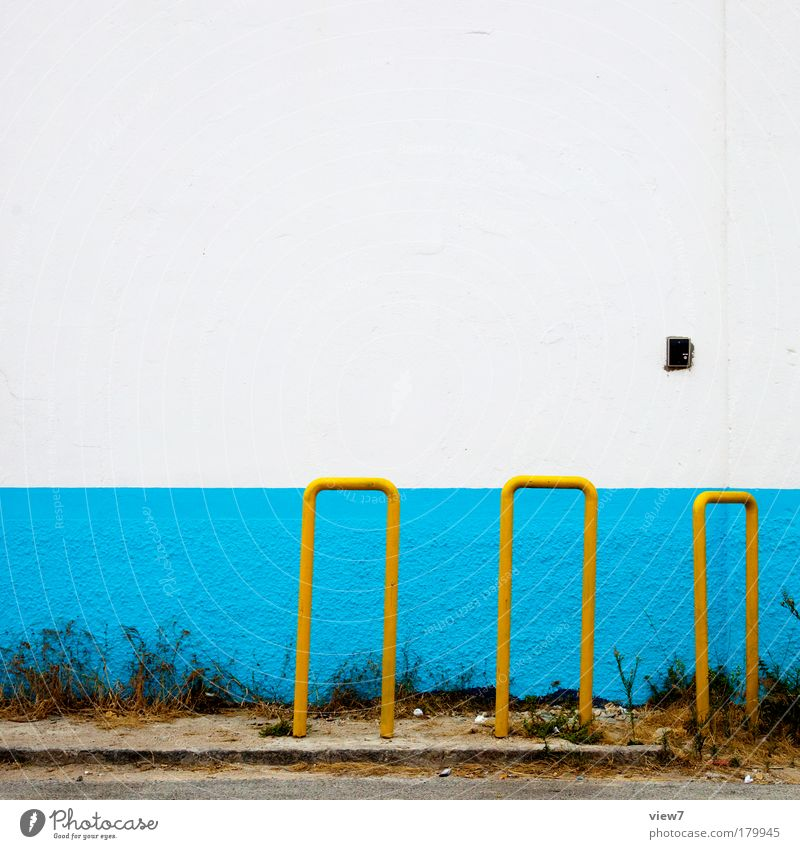 bicycle stands Multicoloured Detail Deserted Copy Space top Deep depth of field Central perspective Wall (barrier) Wall (building) Facade Metal Authentic Simple