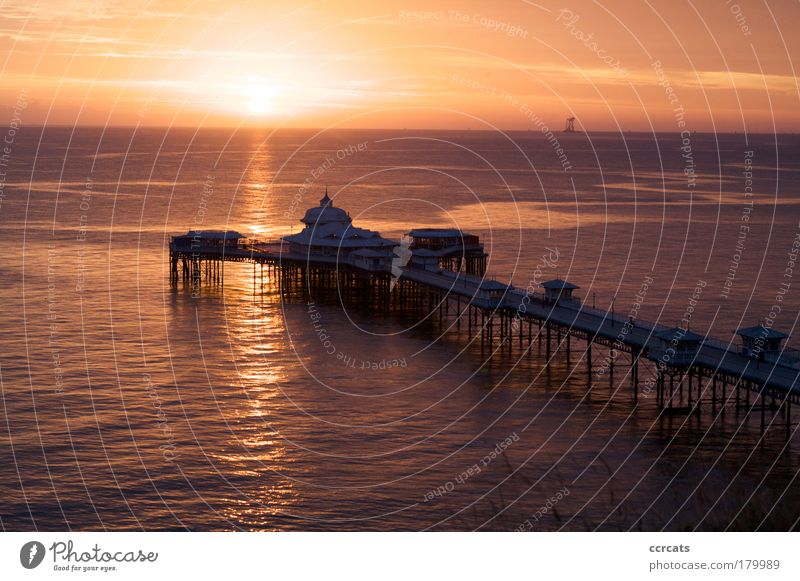 Sun rising over Llandudno pier Nature Water Ocean Beach Relaxation Autumn Wood Dream Building Landscape Coast Architecture Environment Large Energy Europe