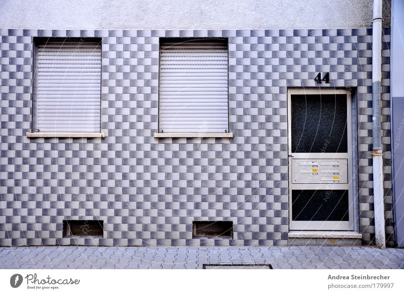 facade monotony Colour photo Subdued colour Exterior shot Pattern Deserted Day Central perspective Flat (apartment) Village Town House (Residential Structure)