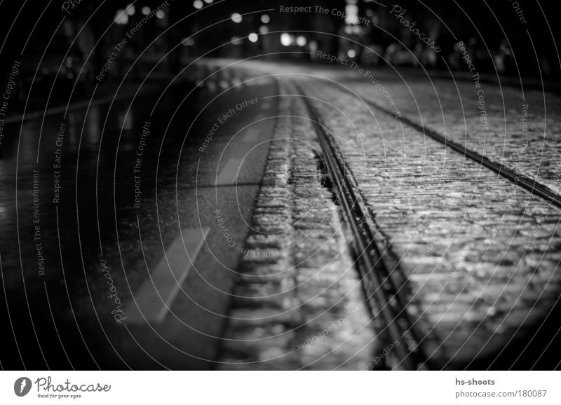 City Loneliness Street Rain Night Germany Transport Railroad tracks Traffic infrastructure Expectation Tram Commuter trains Means of transport Freiburg im Breisgau Black & white photo Train travel