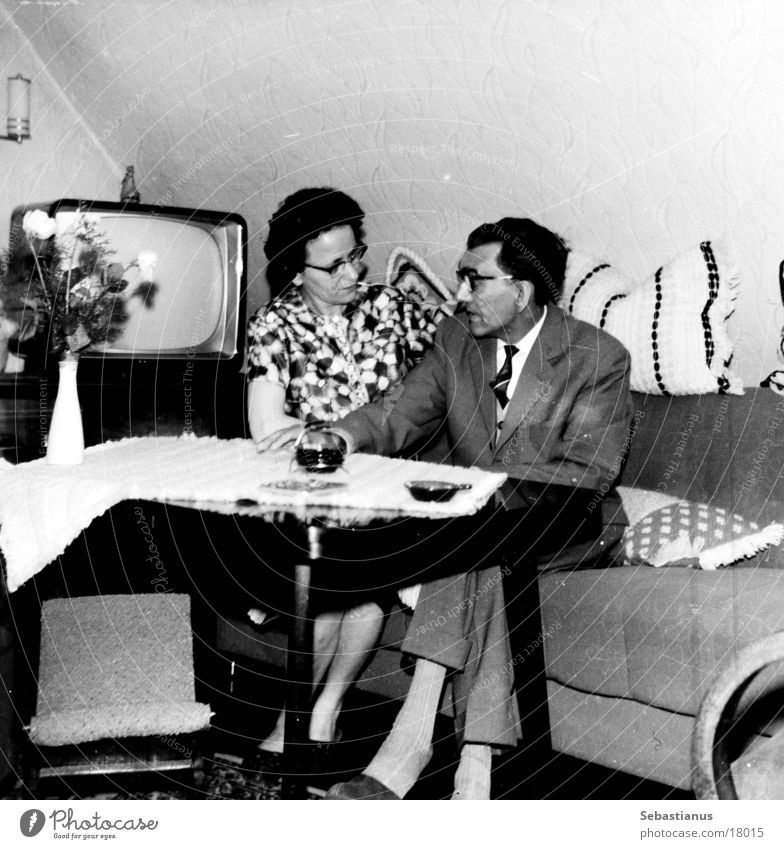 TV - with man and woman Man Woman TV set Living room Sixties Sofa Black & white photo