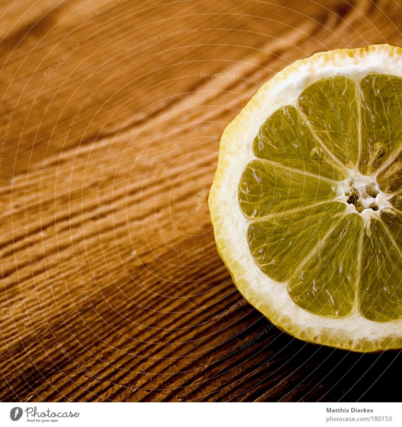 lemon Lemon Ingredients Fruit Citrus fruits Fruit flesh Yellow Sour Wooden board Healthy Vitamin C Nutrition Sense of taste Effort Delicious Juice Cut Half