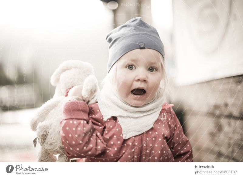 not scared, not happy ;) Human being Feminine Toddler Girl Head 1 - 3 years Scarf Cap Blonde Emotions Defiant Exterior shot Blur Long shot