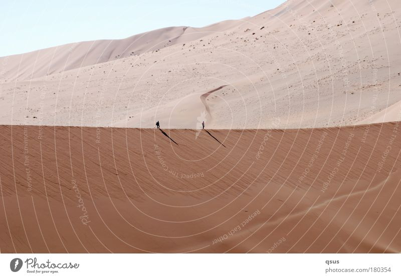 Ridge walk II Dune 2 Human being Large Small Sand Desert Warmth Nature Shadow mountainous Hiking man and nature Bright reading direction Infinity Far-off places