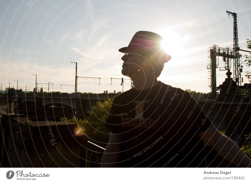 With hat Colour photo Subdued colour Exterior shot Day Evening Shadow Reflection Sunlight Sunbeam Back-light Portrait photograph Upper body Forward Lifestyle