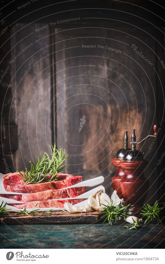 Steaks with herbs and pepper mill on a rustic kitchen table Food Meat Herbs and spices Nutrition Lunch Dinner Buffet Brunch Banquet Organic produce Style Design