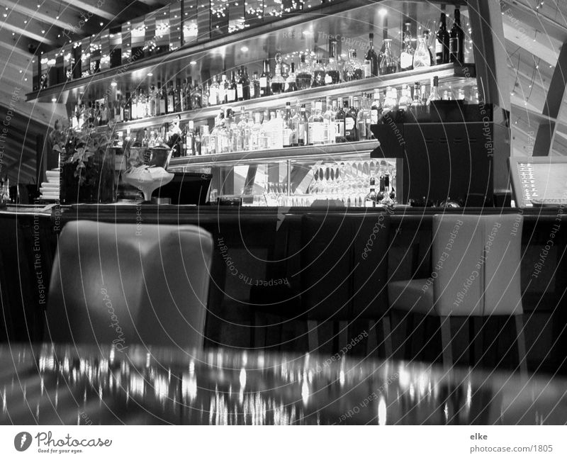 in cash Bar Mirror Table Nutrition Bottle Glass Chair Black & white photo