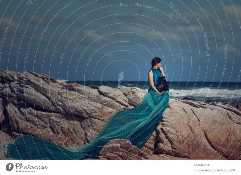 Human being Woman Sky Nature Summer Ocean Clouds Far-off places Beach Adults Environment Coast Feminine Lamp Freedom Rock