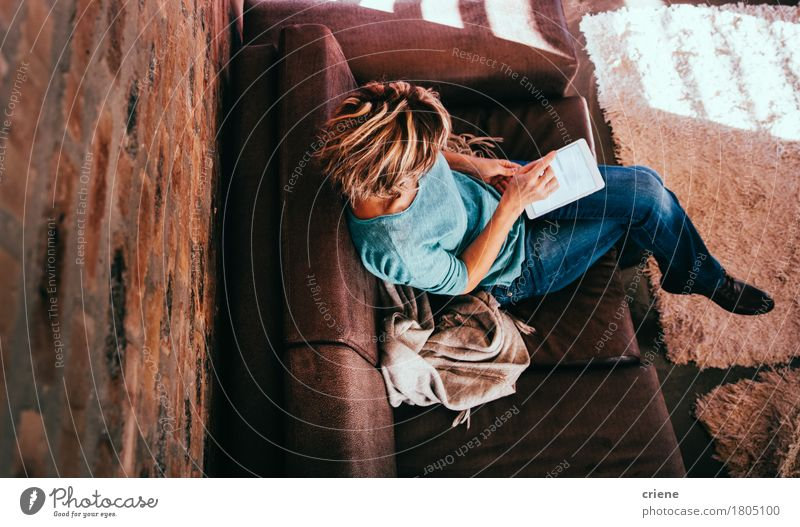 High Angle View of Woman using digital tablet Woman House (Residential Structure) Senior citizen Lifestyle Business Work and employment Living or residing Office Modern Communicate Technology 50 plus Female senior Internet Home Mature