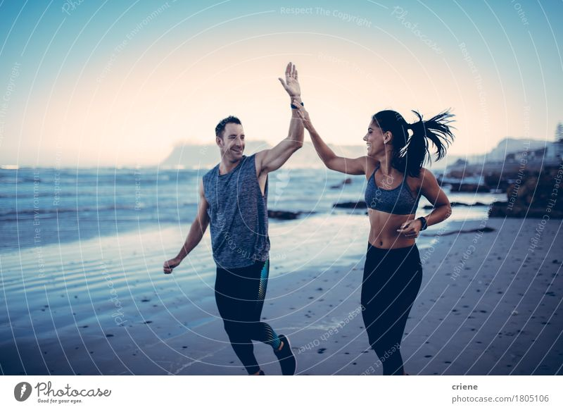 Fit Couple giving each other high five Human being Youth (Young adults) Young woman Young man Ocean Beach 18 - 30 years Adults Lifestyle Sports Healthy Happy