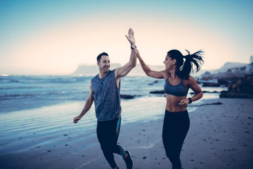 Fit Couple giving each other high five Lifestyle Body Healthy Health care Athletic Fitness Leisure and hobbies Beach Sports Sports Training Jogging Human being