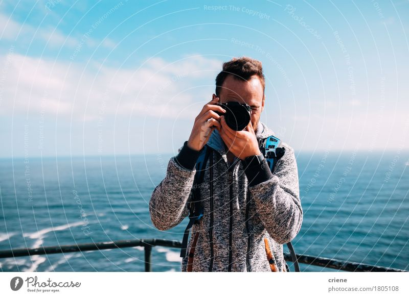 Man taking photo with vintage camera on holiday Lifestyle Leisure and hobbies Vacation & Travel Summer Beach Ocean Waves Camera Technology Human being Young man