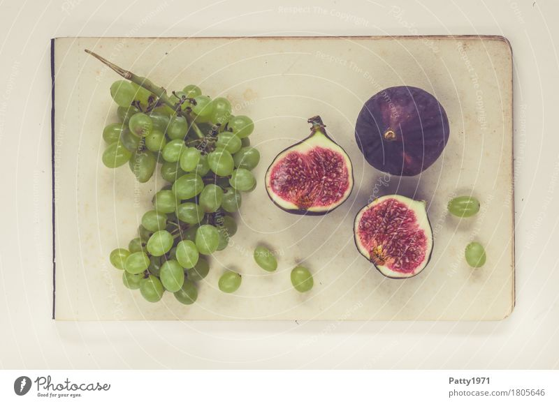 Grapes and figs Food Fruit Bunch of grapes Fig Still Life Nutrition Vegetarian diet Paper Piece of paper Fresh Healthy Retro Round Sweet Soft Green Violet Red