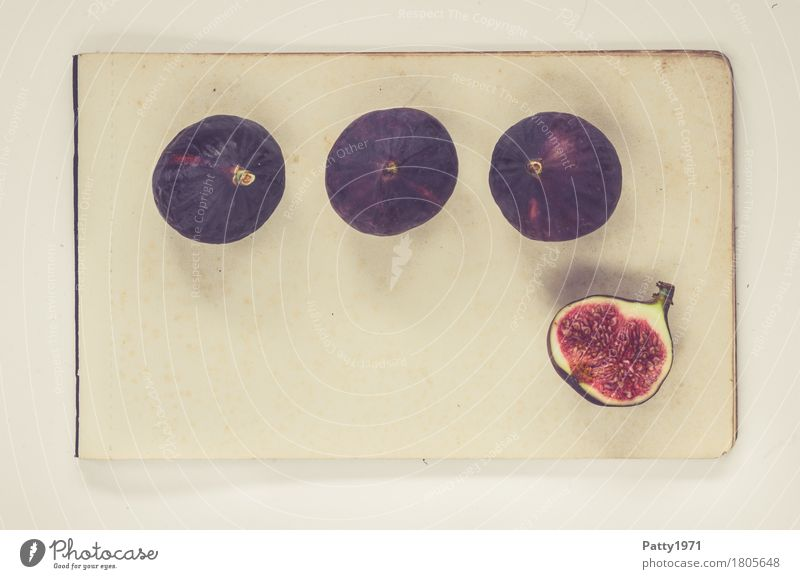 figs Food Fruit Fig Nutrition Vegetarian diet Paper Piece of paper Fresh Healthy Retro Round Juicy Sweet Violet Red Still Life Colour photo Studio shot Deserted