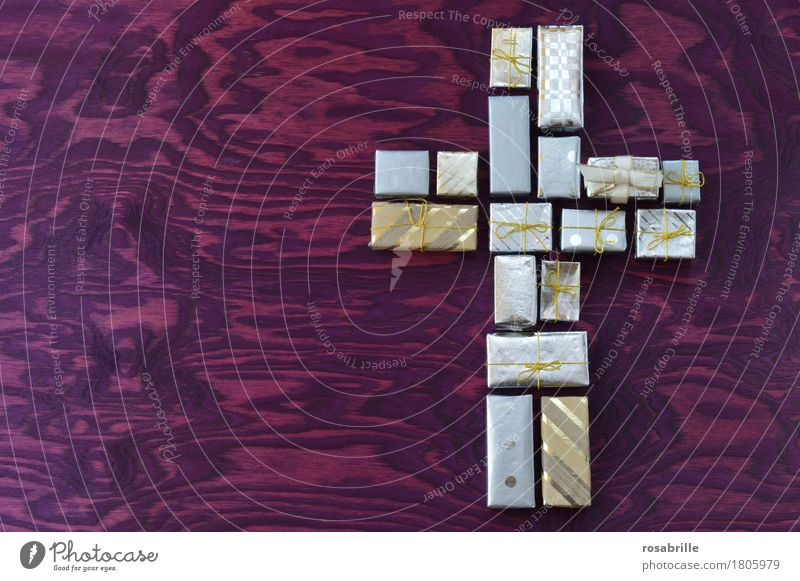 Good Friday gift - many small gifts together form a cross on a purple wooden background Easter Packaging Decoration Bow Gift Sign Crucifix Feasts & Celebrations