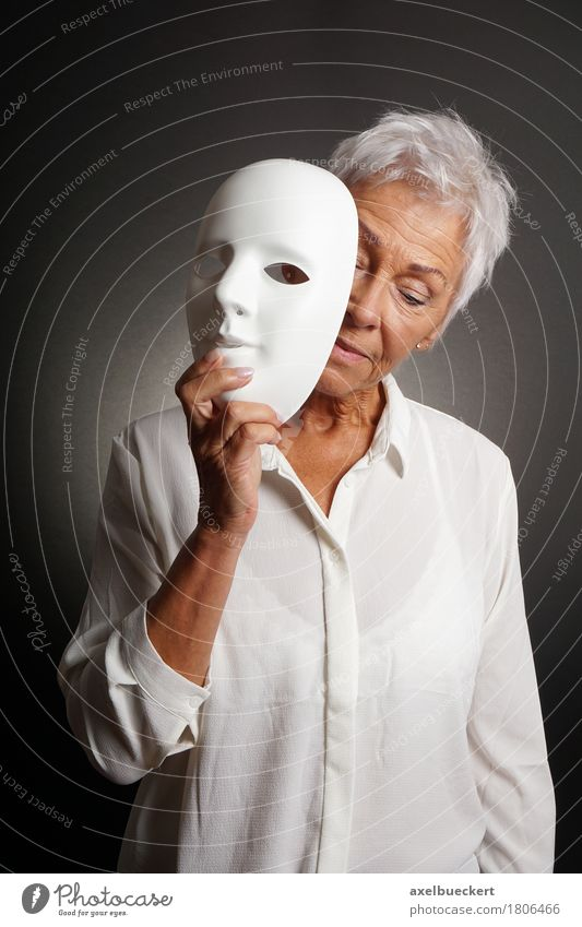 mature woman revaling sad face behind mask Human being Woman White Face Adults Sadness Emotions Senior citizen 60 years and older Female senior Mask Hide