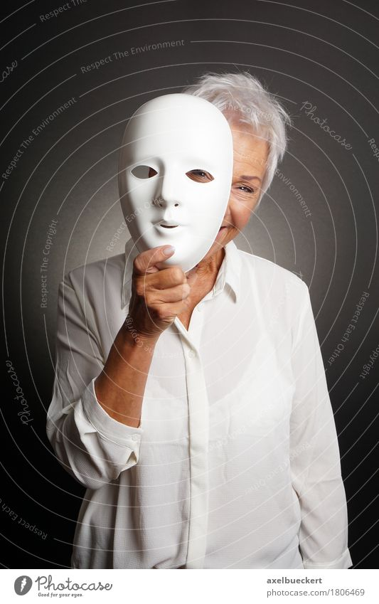 happy mature woman peeking from behind mask Human being Woman White Joy Adults Senior citizen Funny Playing Laughter Happiness 60 years and older Smiling Uniqueness Female senior Mask Grandmother