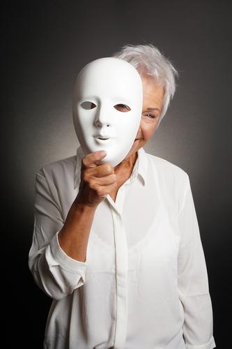 happy mature woman peeking from behind mask Joy Playing Human being Woman Adults Female senior Grandmother Senior citizen 1 60 years and older Actor Smiling