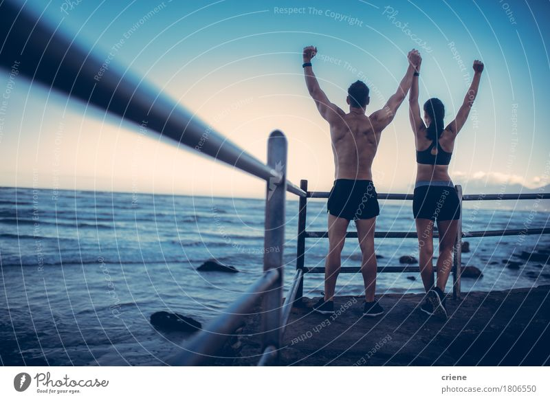 Fitness Couple doing conquering pose after Run at the beach Human being Youth (Young adults) Ocean Beach 18 - 30 years Adults Lifestyle Sports Happy Couple Together Fitness Running Relationship Partner Pride
