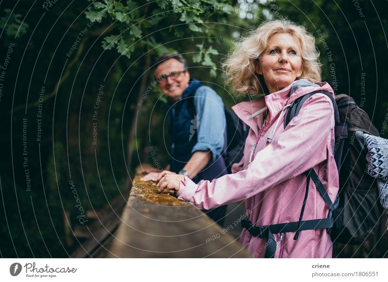 Senior Couple enjoying hike in the forest Woman Nature Man Relaxation Joy Forest Senior citizen Lifestyle Sports Leisure and hobbies Hiking To enjoy Smiling