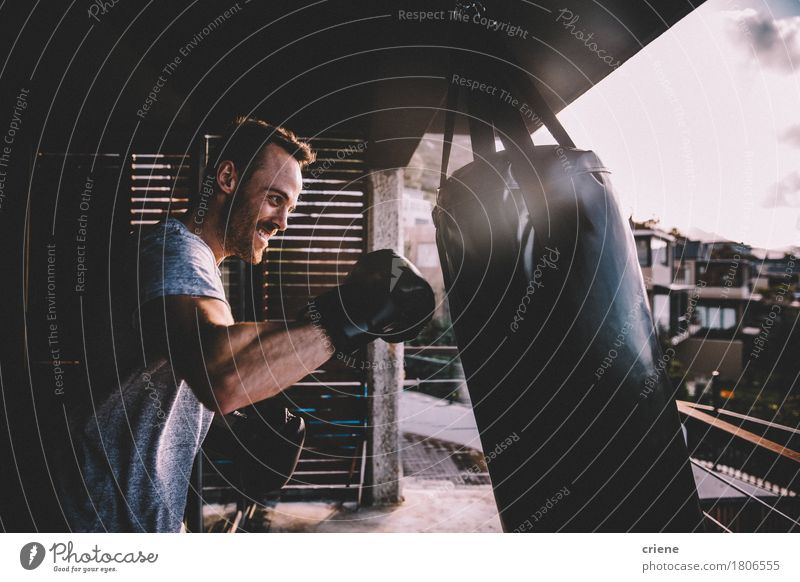Young adult man doing boxing workout at home on his balcony Human being Youth (Young adults) Man House (Residential Structure) 18 - 30 years Adults Lifestyle
