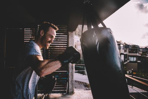 Young adult man doing boxing workout at home on his balcony Lifestyle Personal hygiene House (Residential Structure) Sports Fitness Sports Training Human being