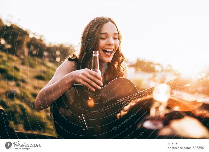Young adult woman enjoying beer and playing guitar Human being Youth (Young adults) Summer Young woman Joy Girl 18 - 30 years Adults Lifestyle Laughter Happy Freedom Music Happiness Smiling Beverage