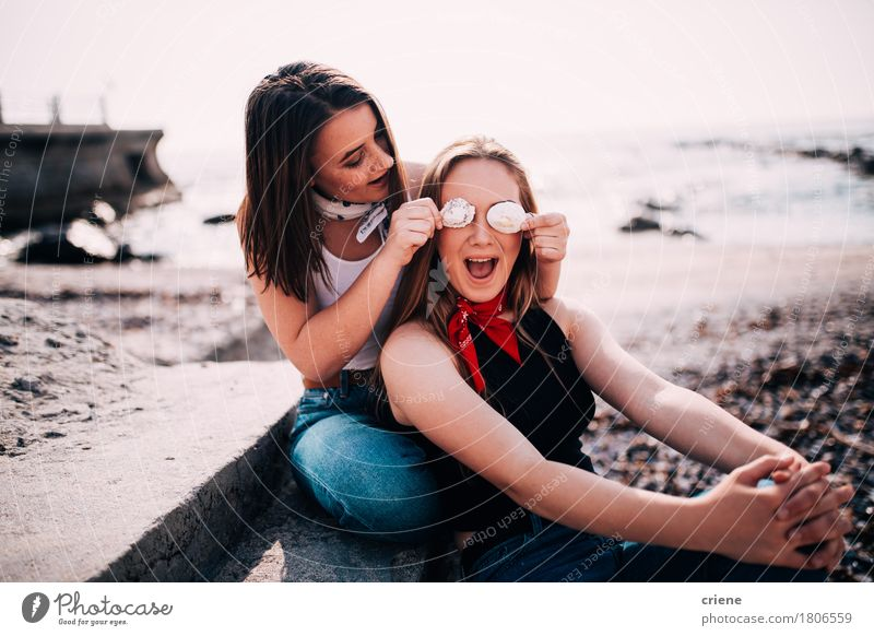 Teenager girls having fun pulling faces at the beach Human being Woman Youth (Young adults) Summer Ocean Joy Girl Beach Adults Lifestyle Laughter Happy Couple Sand Together Friendship