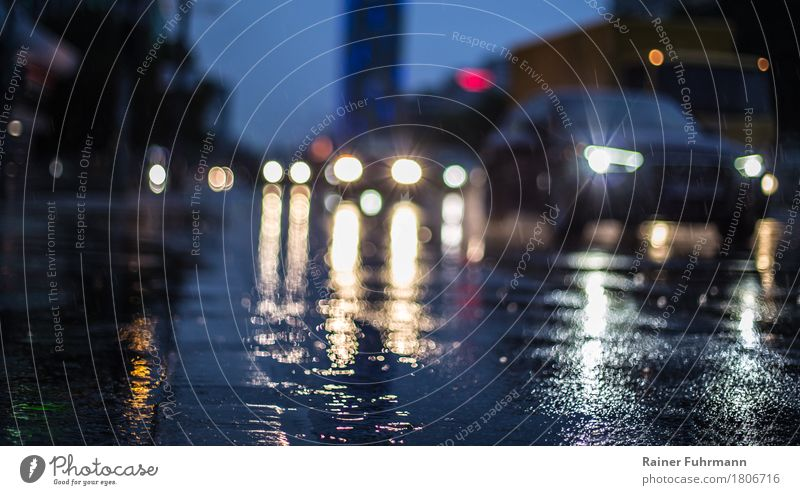 "rain wet streets in a big city Rush hour Road traffic Motoring Street Vehicle Car Driving ""Mirror Rain clearer Floodlight cross hasty Colour photo Exterior shot"