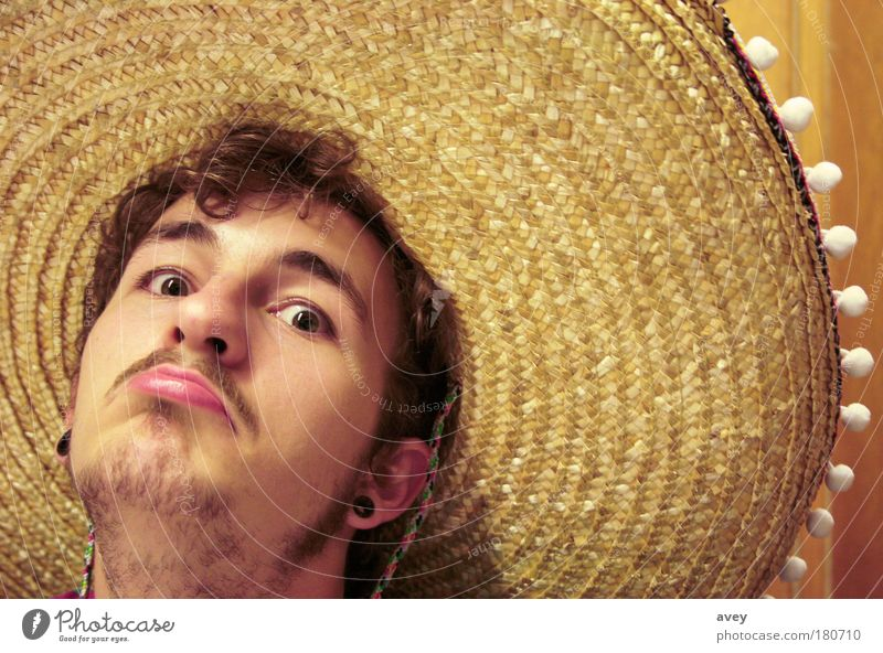 Human being Youth (Young adults) Face Yellow Style Mouth Brown Adults Masculine Observe Hat Mexico Moustache Rebellious Gigantic