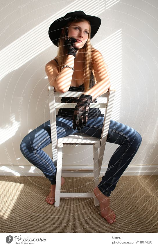 . Chair Room Feminine 1 Human being Shirt Jeans Gloves Barefoot Hat Blonde Long-haired Observe Think Looking Sit Wait Beautiful Cool (slang) Serene Patient