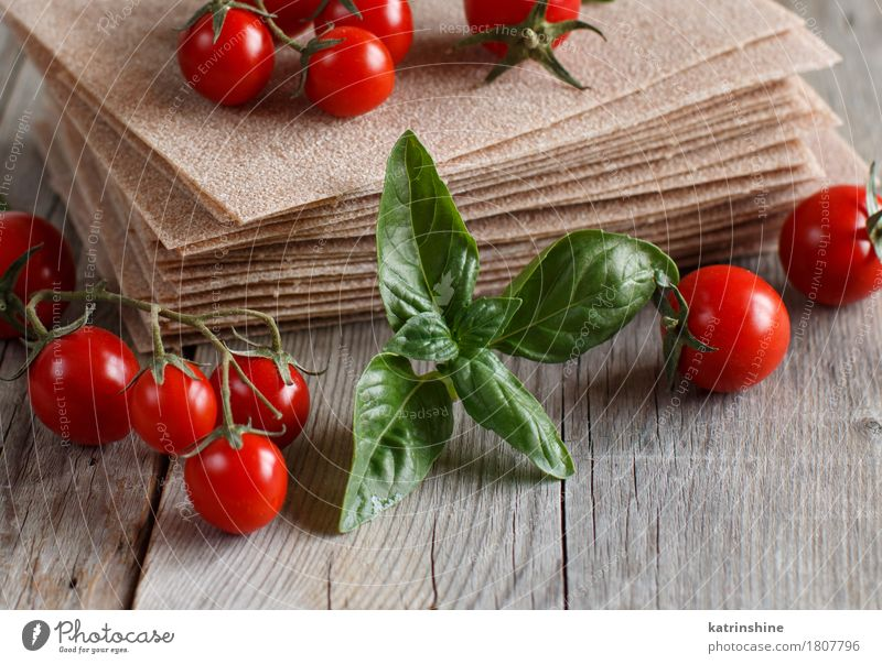Raw lasagna sheets and cherry tomatoes Vegetable Dough Baked goods Nutrition Italian Food Table Old Brown Red Tradition Cooking Culinary food Ingredients