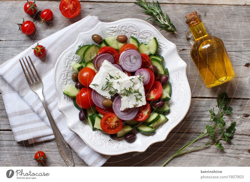 Greek salad Food Cheese Vegetable Eating Lunch Dinner Vegetarian diet Plate Bottle Table Wood Fresh Gray Green Red Tomato chery tomatoes Feta cheese Cucumber