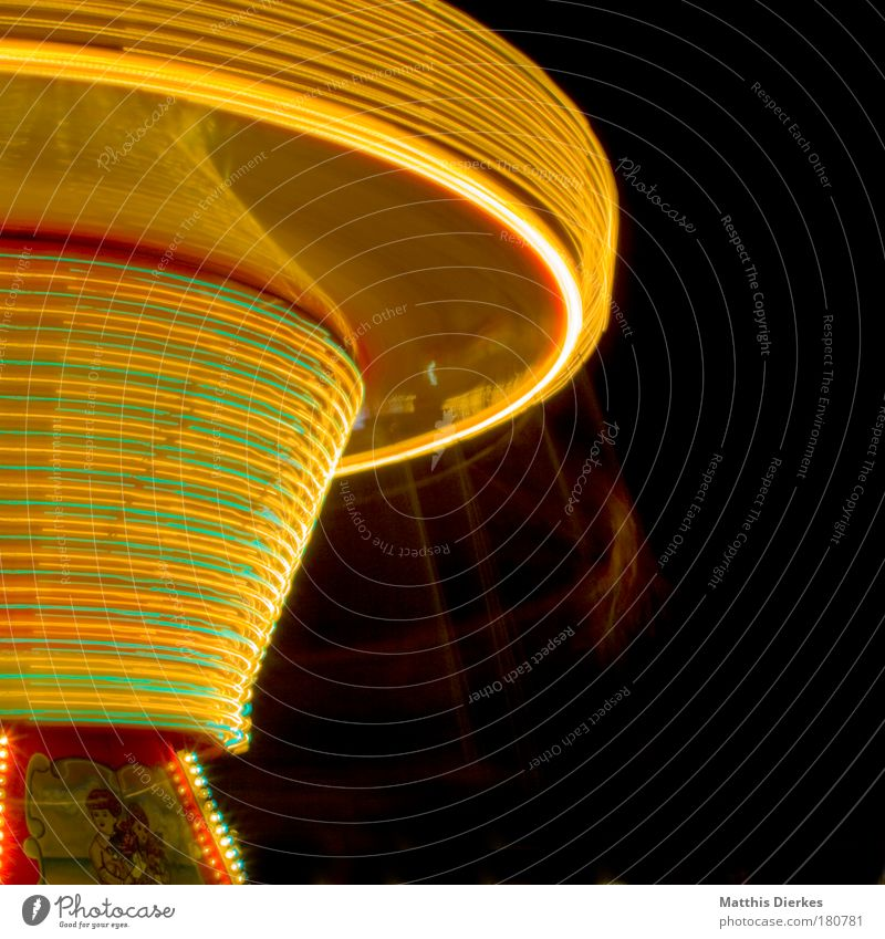 chain carousel Fairs & Carnivals Attraction Theme-park rides Long exposure Gyroscope Giddy Centripetal force Speed of light Showman Night Yellow Tourism