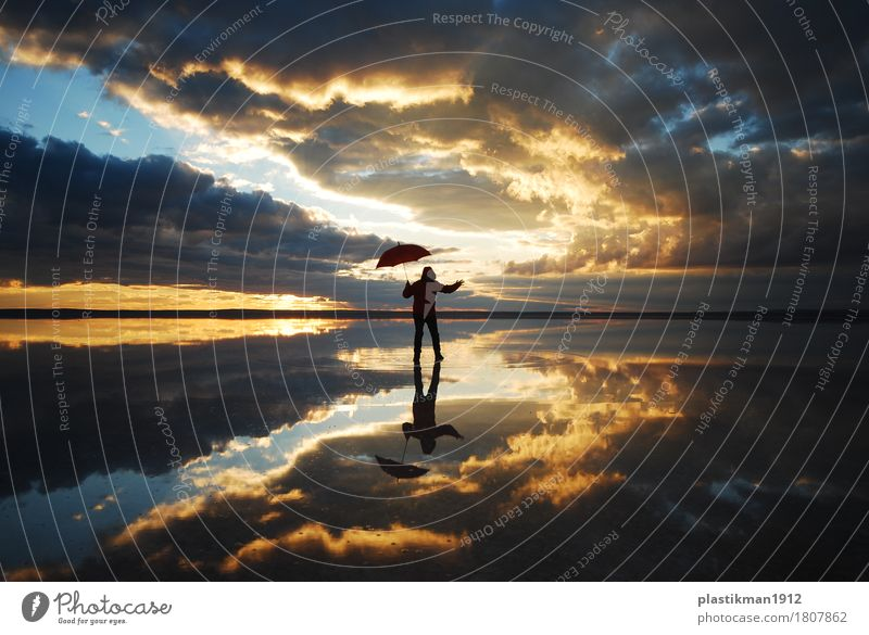 dancing on the lake Human being Man Adults Body 1 Nature Water Sky Clouds Horizon Beautiful weather Lake Fresh Healthy Dance Umbrella Reflection Red Silhouette