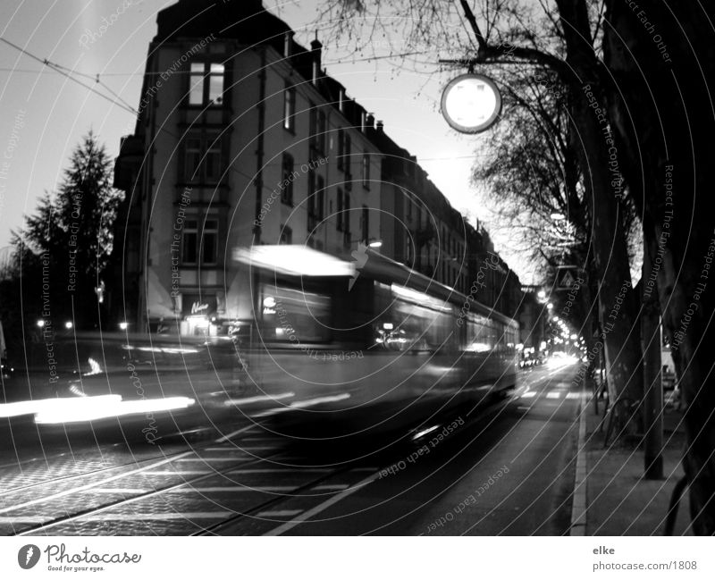 street life House (Residential Structure) Tram Overexposure Railroad tracks Tree Transport Car Black & white photo