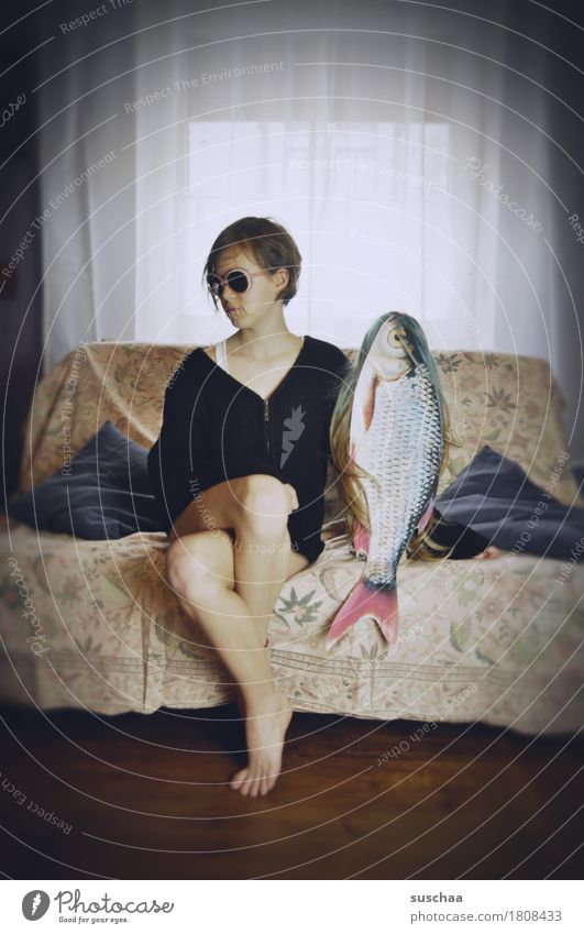 date with fish/outtake Child Girl Young woman Youth (Young adults) Puberty Date Sofa Fish Whimsical Strange Funny Living or residing Flat (apartment) Infancy