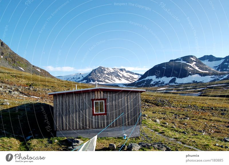 Mountain hut in Sweden Colour photo Exterior shot Deserted Copy Space top Day Deep depth of field Sky Beautiful weather Rock Snowcapped peak Hut Relaxation