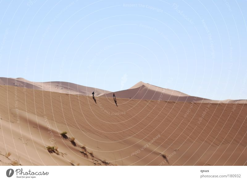 Human being Sky Nature Blue Calm Far-off places Environment Grass Sand Warmth Brown Going Hiking Desert Dune Drought