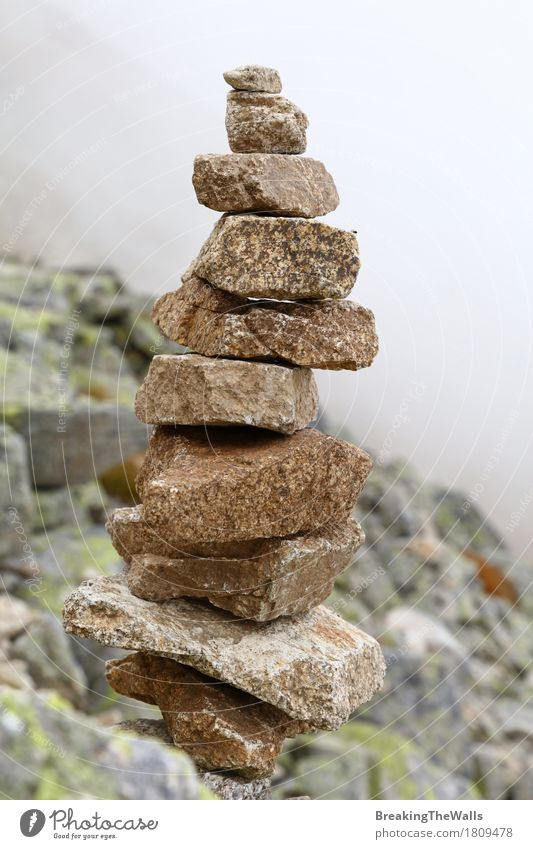 Pyramid of rocks and stones in mountains over fog Nature Vacation & Travel Clouds Far-off places Mountain Lifestyle Stone Rock Tourism Wild Weather Contentment