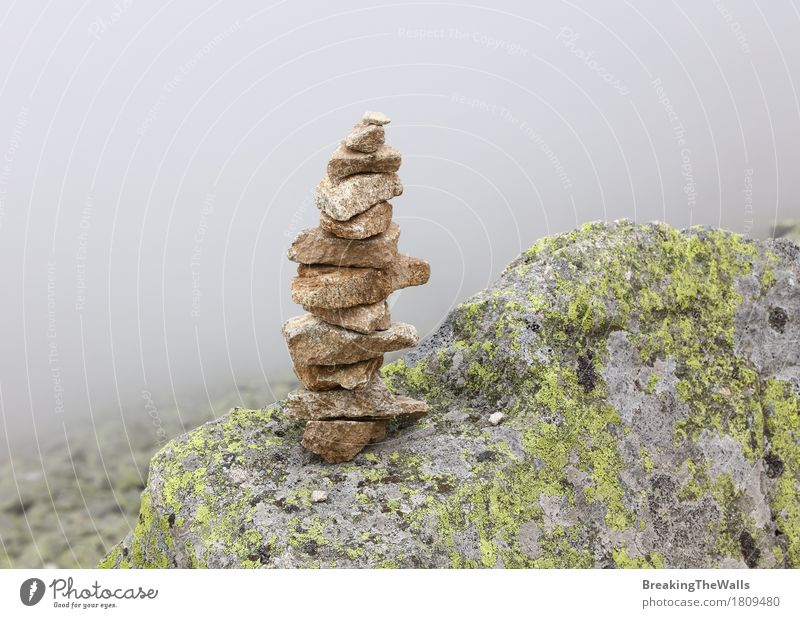 Pyramid of rocks and stones in mountains over fog Vacation & Travel Tourism Trip Adventure Expedition Mountain Hiking Nature Landscape Elements Earth Air Clouds
