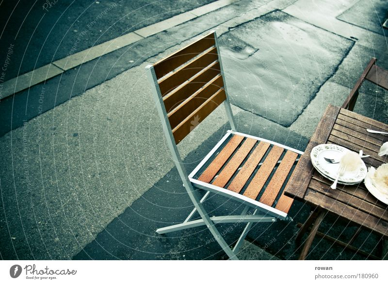 street cafe Colour photo Exterior shot Deserted Copy Space left Day Food Nutrition To have a coffee Crockery Plate Cutlery Wet Chair Table Street Sidewalk