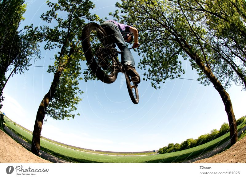 Off through the middle Colour photo Exterior shot Deep depth of field Fisheye Human being Masculine Environment Nature Landscape Cycling Bicycle Jeans Driving