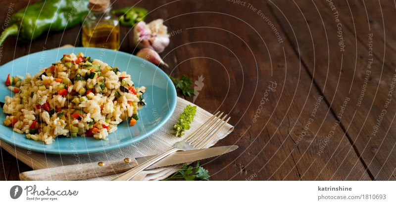 Risotto with vegetables Vegetable Grain Nutrition Lunch Dinner Vegetarian diet Diet Italian Food Plate Bottle Fork Wood Delicious cook Cooking Culinary dieting